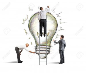 27835792-Business-team-drawing-a-new-idea-in-a-wall-Stock-Photo